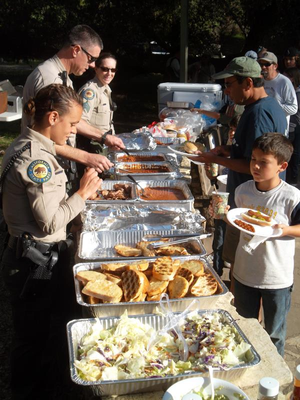 Rangers serve the barbecue on Saturday night. As well as hot dogs, there was chicken, tri-tip beef and veggie-burgers.