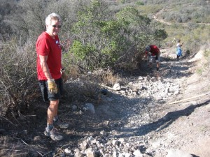 The connector to White Horse Canyon Trail is very rocky because rainwater has washed away all the soil. We removed the biggest and loosest of these rocks.
