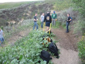 Young sailors working on an upslope switchback drainage