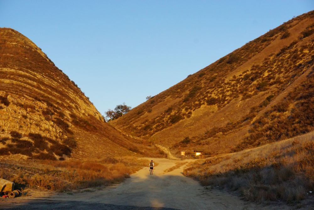 A hiker approaches the De Anza trailhead, which will be hidden behind a hotel