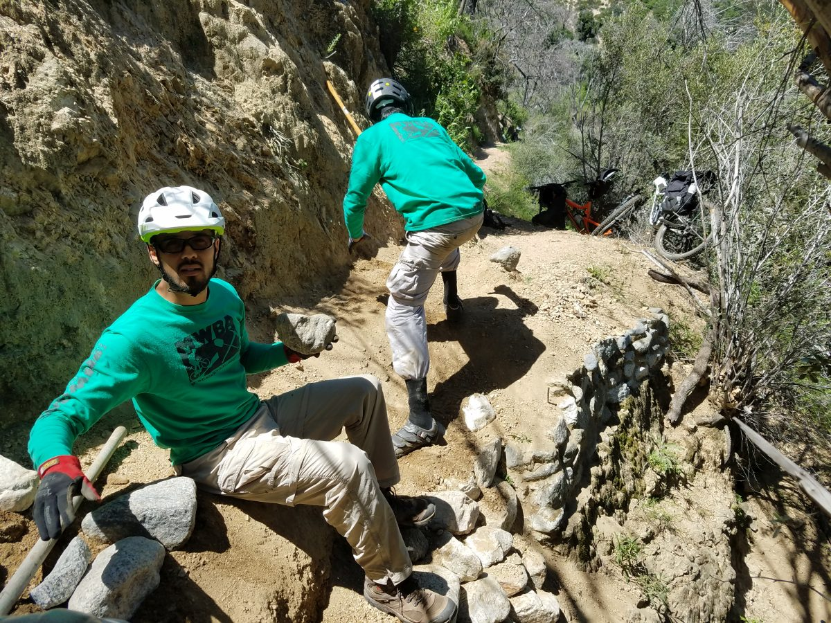 Installing rock retaining walls on the Gabrielino trail