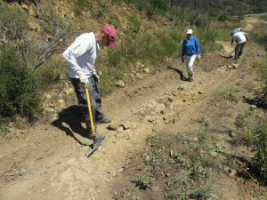 Fixing a rut on the Sin Nombre Trail