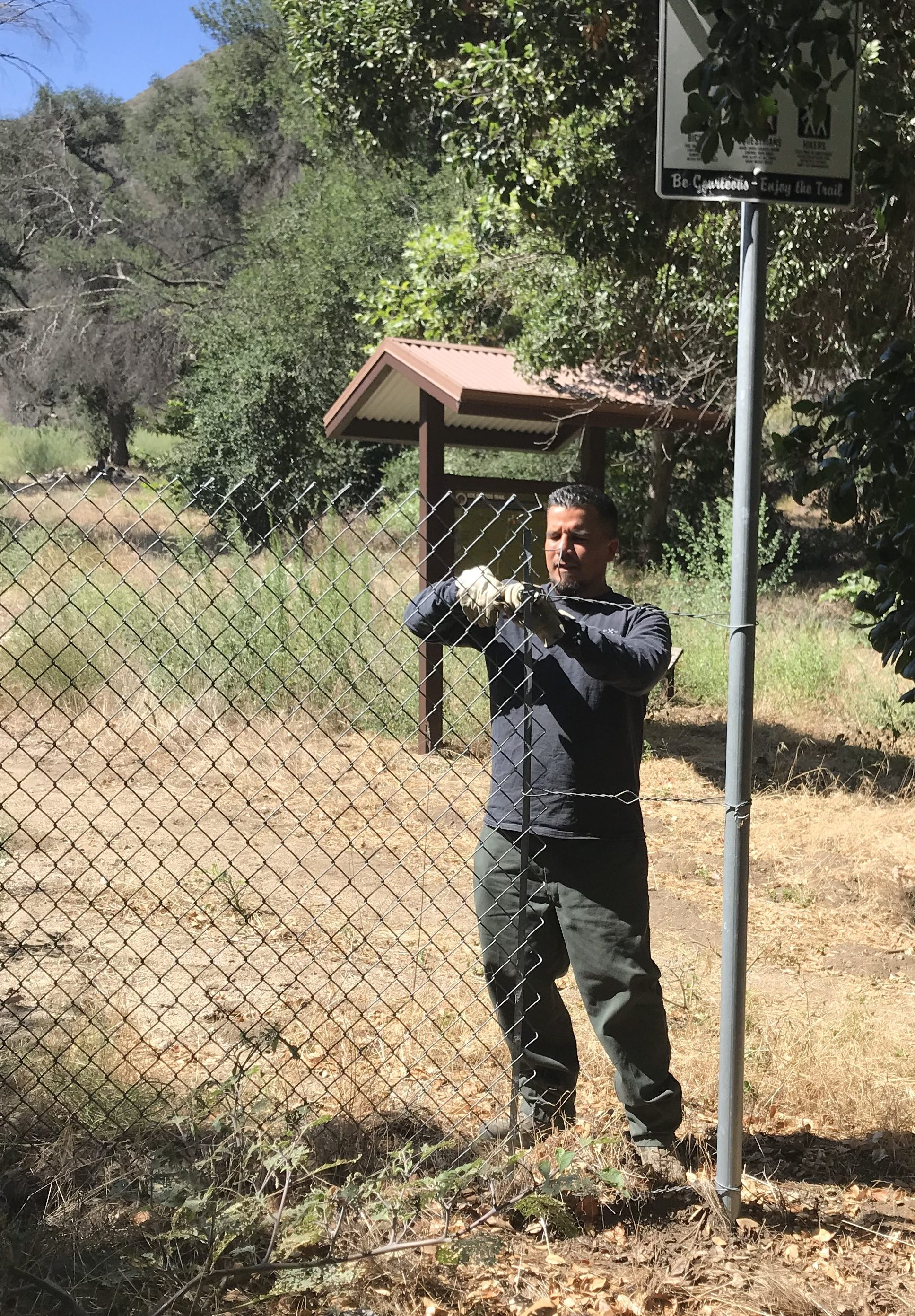 LA County Parks Staff remove the fence at the trailhead, opening the trail